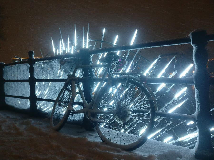 Snowy bike on bridge - with Amsterdam Light Festival artwork