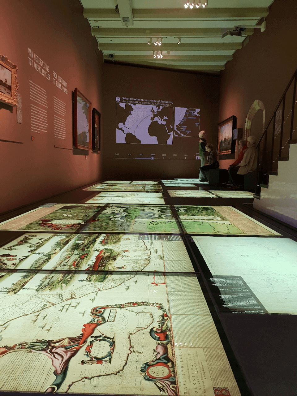 A room filled with historical maps in the Amsterdam Museum. Some of the maps show New York and the borough of Staten Island when it was settled by the Dutch